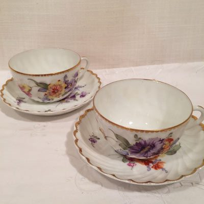 Six Nymphenburg cups and saucers, each painted differently