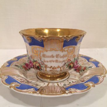 German oversized hand painted cup and saucer, dated 1896. Sold
