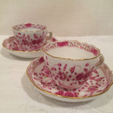 Seven Meissen purple Indian demitasse cups and saucers