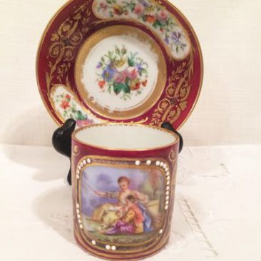 Antique Sevres cup and Saucer, with scene of lovers on cup and bouquet of flowers on saucer, Price on Request.