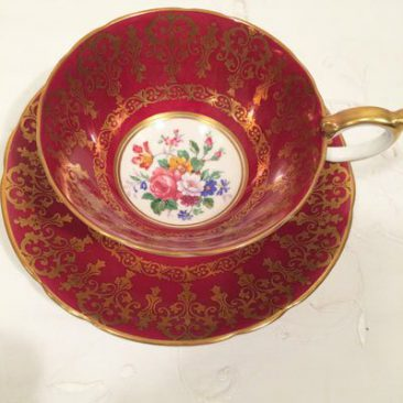Aynsley maroon teacup and saucer, with flower bouquet. Sold