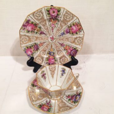 This shows the inside of the cups of the set of twelve Wiswall Dresden octagonal cups and saucers and cake plates