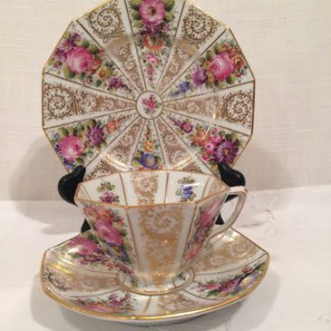 Set of twelve Wiswall Dresden octagonal cups and saucers and cake plates