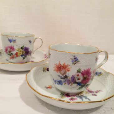 Set of six Meissen cups and saucers each painted with different flower bouquets, Circa 1880s-1890s.  Sold.