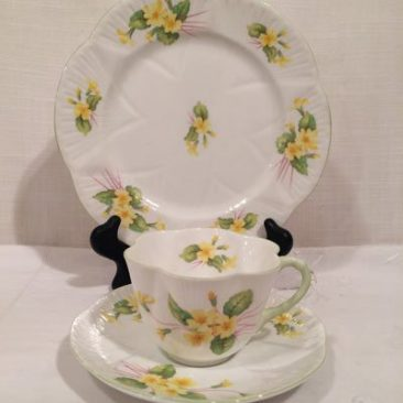 Set of five Shelley primrose teacups and saucers and cake plates, sugar and creamer is also available, $125 for each trio