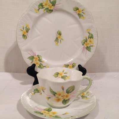 Set of six Shelley primrose teacups and saucers and cake plates