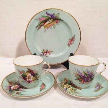 Four Royal Worcester cups and saucers and cake plates, Circa 1878, each painted with different flowers, each trio is $140.