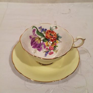 Yellow Paragon teacup with bouquet of flowers and purple tulip. Sold