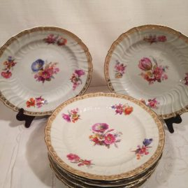 Set of nine KPM dinner plates, each painted with different bouquets of flowers, Diameter-9 5/8 inches. Circa-1900. Price on Request
