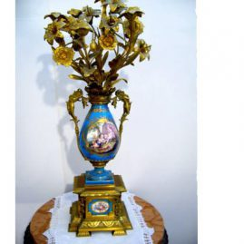 Sevres bronze and porcelain candlelabra with handles of art nuveau ladies and paintings of putti and flowers