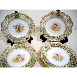 Seven Ambrosius Lamm Dresden reticulated cherub plates, each hand painted with different scenes of cherubs. Circa-1890s. 8 1/2 inch diameter. Sold