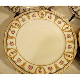 Close-up of one of the set of fourteen William Guerin Limoges dinner plates, in Sevres style decoration