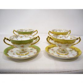 Set of 11 Lamb Dresden desserts or cream soups with raised gilt decoration, 6 yellow and 5 green, 1880s-1890s, sold