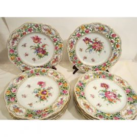 Set of twelve Dresden reticulated dinner plates, each painted with different bouquets of flowers