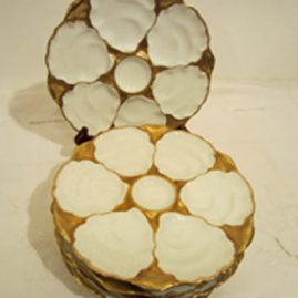 Set of six Charles Ahrenfeldt Limoges gilded oyster plates