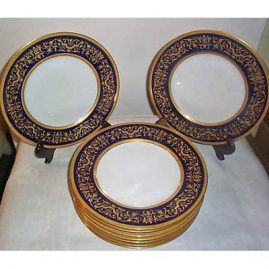 11 Hutchenreuther cobalt and gold service plates, with raised gilding, !0 3/4 inches, sold
