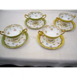 Inside of set of 11 Lamb Dresden desserts or cream soups with raised gilt decoration, 6 yellow and 5 green, 1880s-1890s, sold