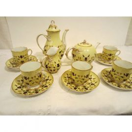 Rare Berlin KPM tea and coffee service, with raised enameling and raised gilding; includes a teapot, a coffee pot and five cups and saucers. Late 19th century. Sold