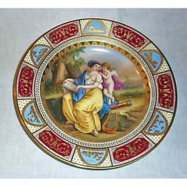 Royal Vienna plate of lady and cherub, underglaze blue beehive mark, 9 1/2 inches, Sold