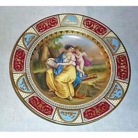 Royal Vienna plate of lady and cherub, underglaze blue beehive mark