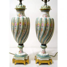 Pair of Sevres style lamps with raised gilding and hand painted flowers, late 19th to early 20th century, 14 inches to metal harp, 27 1/2 inches with metal harp and fineal. Sold