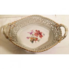 Large Berlin KPM reticulated Bowl with hand painted flower bouquet and butterfly. Late 19th century. 15 1/4 inches by 10 1/4 inches .Price on Request.