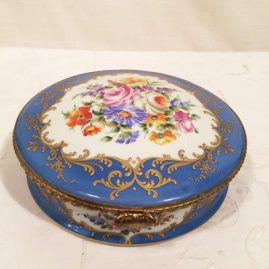 Le Tallec Paris round porcelain box with beautiful hand painting and raised gilding. Made especially for Thos Goode and Co., London, diameter is 8 inches, height is 2 inches tall. Price on Request.