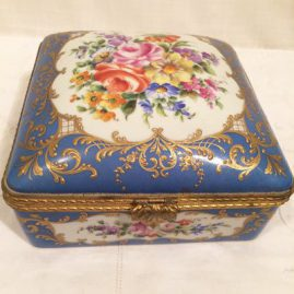 Le Tallec square Porcelain Box with beautiful hand painted bouquets and raised gilding. It is 7 by 7 inches and 3 1/2 inches tall. Price on Request.