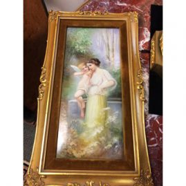 Limoges porcelain plaque of lady with a cherub