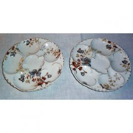 Pair of Haviland Limoges oyster plates, 1876-1880, sold
