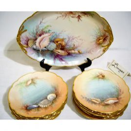 "Jean Pouyat Limoges France sea shell dessert or appetizer set with platter and 12 plates each painted with different sea shells, artist signed V.A. Bartlett. Platter-14 1/2"" by 9 3/4"", Plates-7 3/4"", ca-1905, Sold"