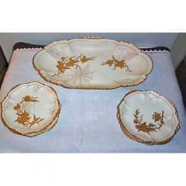 Limoges 7 piece spider pattern dessert set, platter  and 6 cake plates with raised gilting, Sold