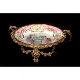 "Pink ""Sevres"" scenic centerpiece with bronze mounts artist signed.; 17 inches, Sold."