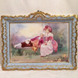 Limoges Porcelain plaque with scene of lovers, artist signed.  The lady is painted with a pink hat and her lover is reading to her in the park. 14 inches wide by 10 3/4 inches tall. Price on Request.