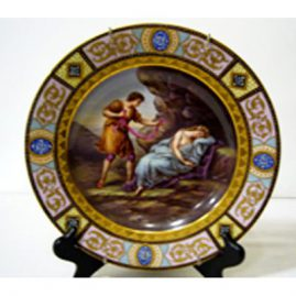 Royal Vienna plate of lovers with profuse raised gilding and raised enameling, 9 3/4 inches, Sold