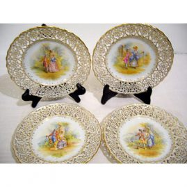 Four Ambrosius Lamm Dresden reticulated plates of lovers, Each plate is hand painted with different scenes of lovers. 6 3/4 inches, circa -1890s. Sold.