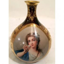 Royal Vienna gilded vase artist signed Wagner of Madame Pompadour, Late 19th century, early 20th century, 6 3/8 inches tall by 6 inches wide. Sold.