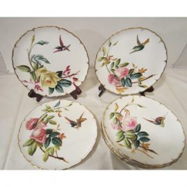 Set of eight rare George Jones late 19th century hummingbird and rose plates. The hummingbirds and roses are raised. Each plate is painted differently with different hummingbirds and roses. Roses vary from white to pink to yellow to red. 9 inches. Sold