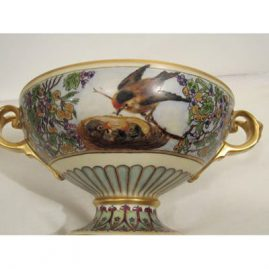 Large Rosenthal center bowl with masked handles and a luster finish inside the bowl, artist signed Peterson, 17 inches wide by 6 5/8 inches tall. Sold.