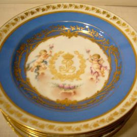 Set of eight Louis Philippe Sevres wide rim soups with cherub