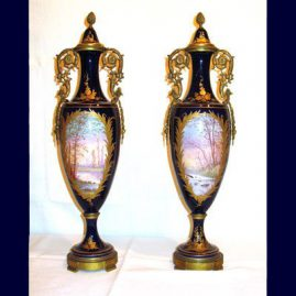 "Back of a pair of cobalt and gold ""Sevres"" urns, with lovers on the other side"