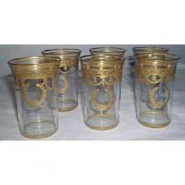 7 gilded aperitifs, 3 1/2 inches, bow and wreath decoration, Sold