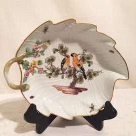 Meissen leaf shaped dish painted with birds and bugs and having raised flowers around the handle. We have two leaf dishes in stock, each painted with different birds. Circa-1870s-1880s. Width-8 1/2 inches by 7 inches long. Price on Request.