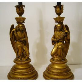 Pair of rare bronze candlesticks with wood bases of Archangels