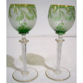 Set of eight cut cameo wine goblets with air twisted stems, 8 inches tall. Sold.