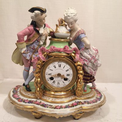 Picture of French figural clock without dome and base with bisque and porcelain figures of man and woman