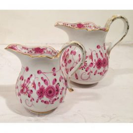 Two Meissen purple Indian creamers. First creamer is five inches tall, second creamer is six inches tall. Circa-1880s. Prices on Request