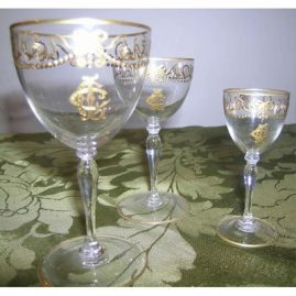 "Gilded crystal with bows and swags, 7 ports-4 1/2"", 9 cordials-4"", Price on Request"