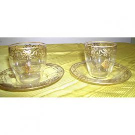 8 demitasse cups and saucers with raised gilding with bows and swags