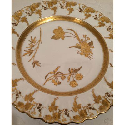 Set of twelve gilded and fluted Copeland dinner plates each painted with different wild flowers